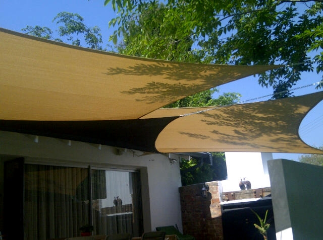 Shade sails over entertainment area