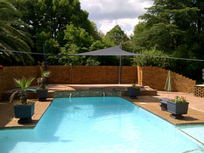 Square shade sail over pool