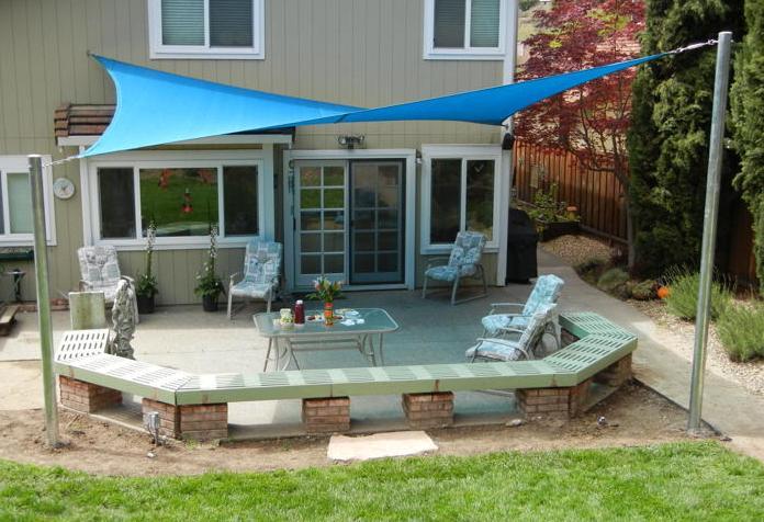 Backyard entertainment area shade sail